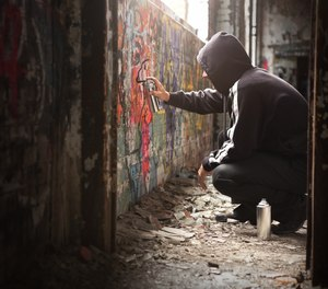 Tagging and gang graffiti cost cities both money and time. This app can help track graffiti and recoup costs of abatement. (Image/Getty)