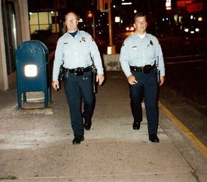 The late officer Jeff Graves and his son officer Heath Graves of the La Crosse Police Department walking the beat.