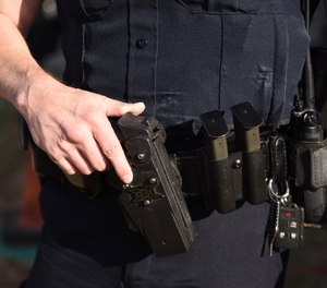 With a strategically positioned backup blade, law enforcers can still use one hand to maintain critical retention of their firearm, while deploying the blade to stop the threat. (Photo/PoliceOne)