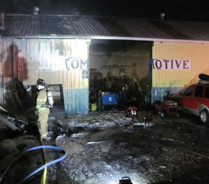 Firefighting efforts during a blaze at a towing company building were reportedly disrupted due to an employee wielding two axes re-entering the building to look for his cat and becoming aggressive with law enforcement. (Photo/La Pine Rural Fire Protection District)