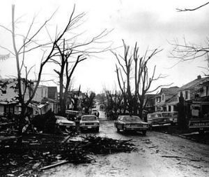 Streets littered with the debris of shattered homes and trees severely hampered travel, including rescue operations. (©1974 John Hultgren, Louisville, Kentucky)
