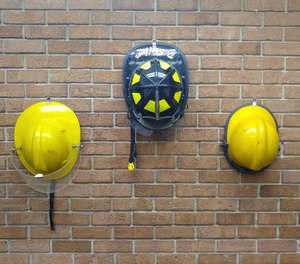 Three generations of helmets line the wall.