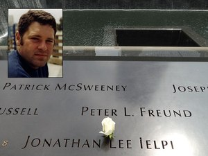A rose has been placed on the name of FDNY Firefighter Jonathan Ielpi at the 9/11 Memorial.
