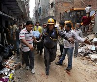 Firefighters search for survivors of 2 India building collapses