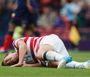Soccer player with a leg injury (AP Photo/Chris Clark)