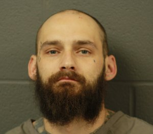 Matthew Lohman, 33, was charged with third-degree assault of a special victim, first-degree property damage and resisting arrest for a felony after allegedly throwing a brick at an ambulance and escaping temporarily from a police car window. (Photo/Cooper County Sheriff's Office)