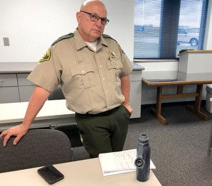 Iowa Sheriff Warren Wethington poses for a portrait at his office in Tipton, Iowa.