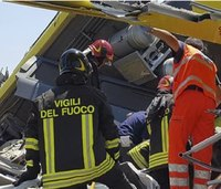 Firefighters work to rescue Italy train-crash victims