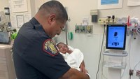 N.J. officer catches baby dropped from balcony; suspect charged