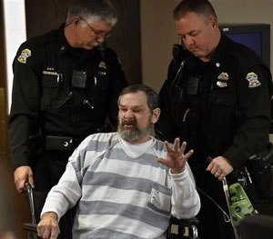 n this April 2014 , file photo, Frazier Glenn Miller Jr., is wheeled out of a Johnson County, Kan., courtroom.