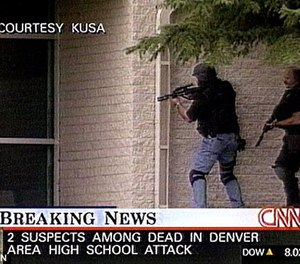 Sgt. James Smith of the Denver Police Department (left, in civilian clothes and a tactical vest and helmet) raced from his home to Columbine High, where he joined an improvised entry team to end the threat posed by the killers. Two minutes after they entered the building, the murderers shot themselves in the library.