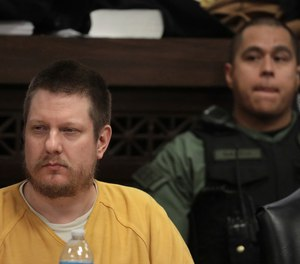 In this Jan. 18, 2019 file photo, former Chicago police Officer Jason Van Dyke attends his sentencing hearing at the Leighton Criminal Court Building in Chicago, for the 2014 shooting of Laquan McDonald.