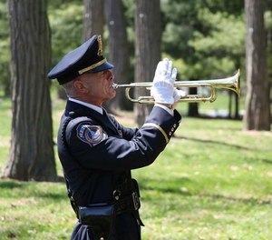 """Officer Jeff Stagg has been an Honor Guard """"TAPS"""" bugler for the past 31 years."""