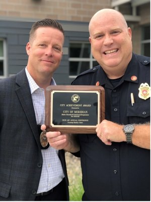 Lt. Shawn Harper and Deputy Chief Joe Bongiorno with their Association of Idaho Cities award for the ISCRS Program.