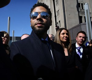Actor Jussie Smollett leaves the Leighton Criminal Court building, after all charges were dropped in his disorderly conduct case on March 26, 2019.