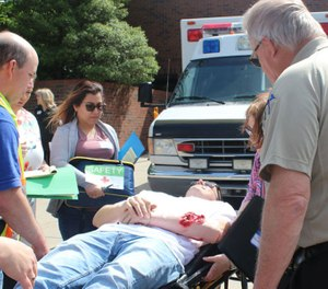 """""""Day In Our Life"""" workshop participants will see a call through, step-by-step, beginning with initial contact to a communication center and realistic trauma and medical scenarios accompanied by actual LifeSave aircraft on-site. (Photo/KEMSA)"""