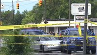 Police: Woman shoots at officer during Juneteenth parade, is killed