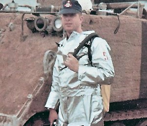 Rescue 5 Bill Killen poses in front of Armored Personnel Carrier #1 during the Apollo 8 Countdown Demonstration Test on Dec. 11, 1968.