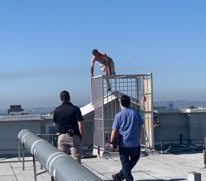 Members of LAPD's Systemwide Mental Assessment Response Team (SMART) negotiate with a man threatening to jump from a structure.