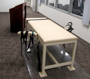 a.In this Oct. 20, 2011 file photo, the execution chamber at the Idaho Maximum Security Institution is shown as Security Institution Warden Randy Blades look on in Boise, Idaho (AP Photo/Jessie L. Bonner, File)