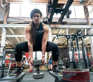 St. Paul Firefighter Sarah Reasoner, a former power lifter, says firefighting has helped her find a higher purpose for her strength. Fire department officials are hoping Reasoner will inspire more women to join the fire service. (Photo/Jerry Holt, Minneapolis Star Tribune)