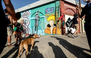 Community members gather for a celebration to honor the life of Atatiana Jefferson on Wednesday, July 15, 2020 in Fort Worth, Texas. Artist Julian Johnson created a mural of Jefferson and the things that brought her joy in life on the corner of Allen and Evans avenues. Image: Amanda McCoy/Fort Worth Star-Telegram via TNS