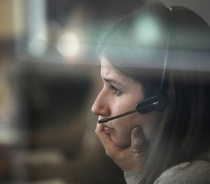 Kathryn Haeffner, an emergency service counselor, provides guidance during a follow-up call at the crisis call center in the DuPage County Health Department on Jan. 6, 2020. (Photo/Stacey Wescott, Chicago Tribune)