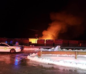 At least two firefighters were injured early Thursday morning during a battle with a fully-involved warehouse. (Photo/Clearfield Fire Department)