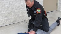 Defensive tactics training: Roll-over to leg-lock to control