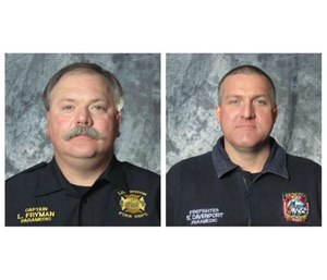 Cpt. Les Fryman and firefighter-paramedic Sean Davenport performed CPR on a woman who had a heart attack during a training conference. (Image courtesy Lexington Fire Department)
