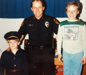 Author Chris Littrell (left) in his Halloween cop uniform, pictured with his father and his brother, an Air Force Security Police veteran, standing in the Seahawks PJs.