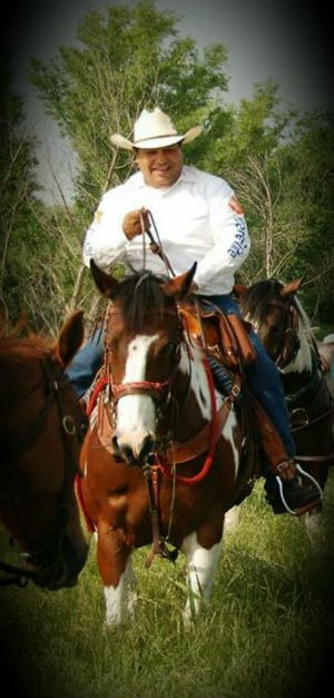 Lozano leading a trail ride for the CareFlite Mounted Equine EMS Team.