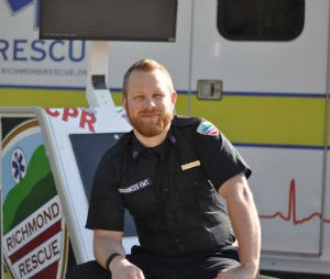 Luke Jackson, AEMT, with the hands-only CPR kiosk he designed and built for Richmond Rescue