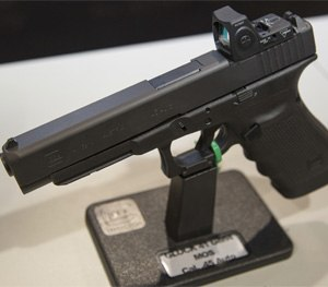 Pictured is a .40 caliber Glock 35 Gen4 pistol with MOS Configuration.