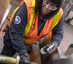 A New York City Metropolitan Transportation Authority worker sanitizes surfaces in high-traffic areas. Image: Patrick Cashin / MTA New York City Transit