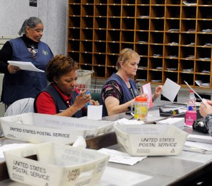 In this Feb. 5, 2016, photo, mail clerks at the Wynne Unit of the Texas prison system inspect boxes of letters for inmates in Huntsville, Texas. (AP Photo/Pat Sullivan)