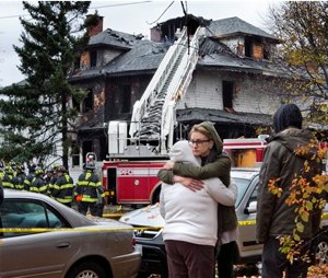 The owner of an apartment house where six people died in a fire that started hours after a Halloween party has been indicted on six counts of manslaughter, authorities announced Friday. (AP Photo/Robert F. Bukaty, File)