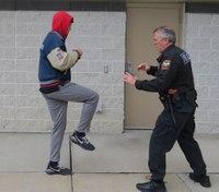 Defensive tactics training: Defeating a front kick