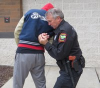 Defensive tactics training: Escape from rear bar arm strangle