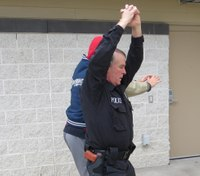 Defensive tactics training: Escape from front strangle