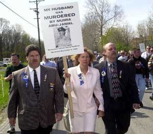 Maureen Faulkner, wife of slain Philadelphia police officer Danny Faulkner, marches with a large group of supporters in April of year 2000.