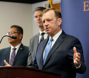 McGregor Scott, the United States Attorney for the Eastern District of California, answers questions concerning the charges against leaders of the white supremacist prison gang, the Aryan Brotherhood, during a news conference in Sacramento