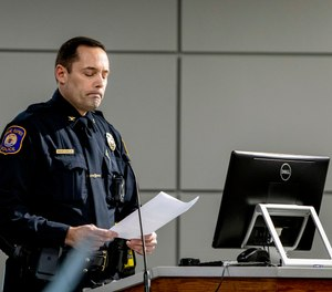 Interim Police Chief David Kiddle speaks during a Grand Rapids City Commission meeting that had a crowd of protesters in Grand Rapids, Mich. (Cory Morse/The Grand Rapids Press via AP)