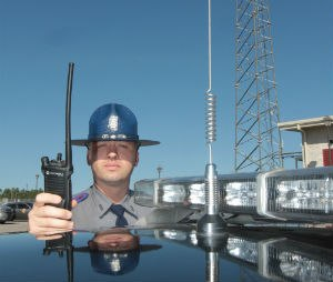Mississippi Highway Patrol Trooper Calvin Robertson holds a Motorola digital radio used in the statewide two-way radio system built by Motorola on Dec. 11, 2013 in Biloxi, Miss. The company also won a contract to build a statewide broadband system in Mississippi, but that project was scrapped. (John Fitzhugh/McClatchy D.C./TNS)