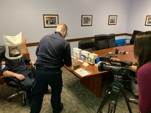 EMS providers from Cumberland Goodwill EMS demonstrate N95 fit test and discuss coronavirus, flu preparedness with local media (Photo/Nathan Harig, Cumberland Goodwill EMS)