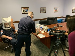 EMS providers from Cumberland Goodwill EMS demonstrate N95 fit test and discuss coronavirus, flu preparedness with local media