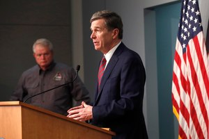 North Carolina Gov. Roy Cooper answers a question during a briefing on the coronavirus pandemic at the Emergency Operations Center in Raleigh, N.C., Tuesday, May 26, 2020. Image: Ethan Hyman/Raleigh News & Observer/TNS