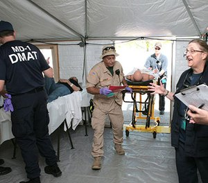 DMAT members from teams across the U.S. work together in response to a mass casualty exercise. DMATs are part of the National Disaster Medical System (NDMS) that boosts the nation's medical response in support of state and local authorities during a disaster. (Courtesy FEMA)