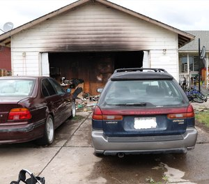 An off-duty Bend firefighter-paramedic rescued a disabled woman from a burning home on Friday.