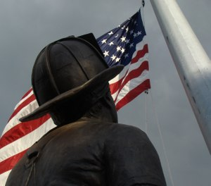 "A 40-foot-tall bronze monument, named ""To Lift a Nation,"" was created by sculptor Stan Watts to honor the heroes of September 11, 2001. Along with the National Fallen Firefighters Memorial, the statue is located on the campus of the National Emergency Training Center in Emmitsburg, Maryland. (Photo NFFF)"